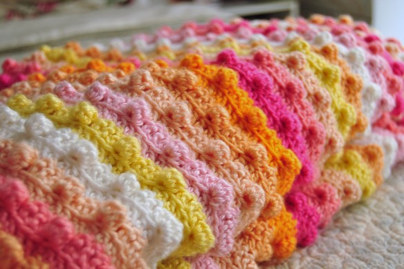 Crocheted bedspread.